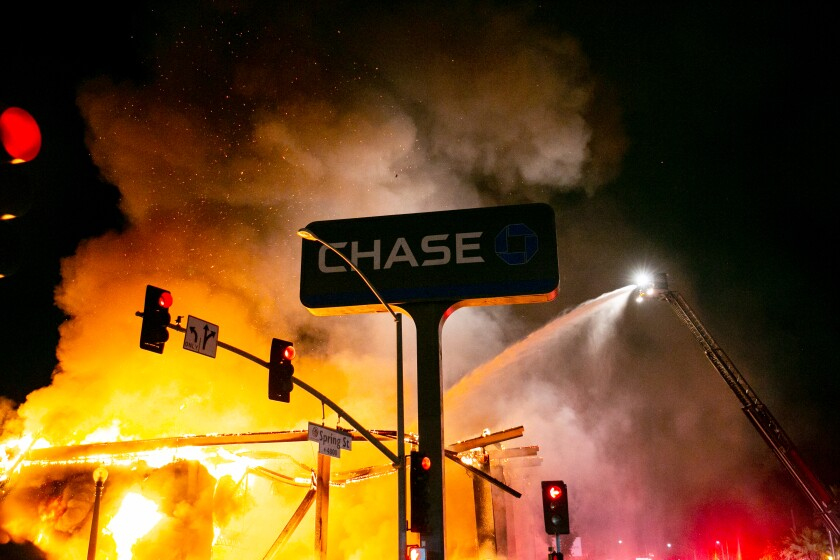 A Chase bank is burned to the ground by looters on May 30, 2020 in La Mesa, California.