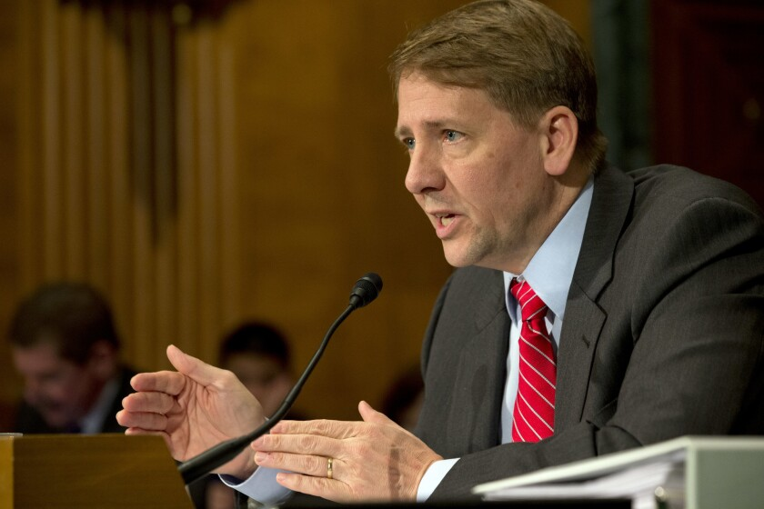 Consumer Financial Protection Bureau Director Richard Cordray testifies on Capitol Hill in Washington in 2013.