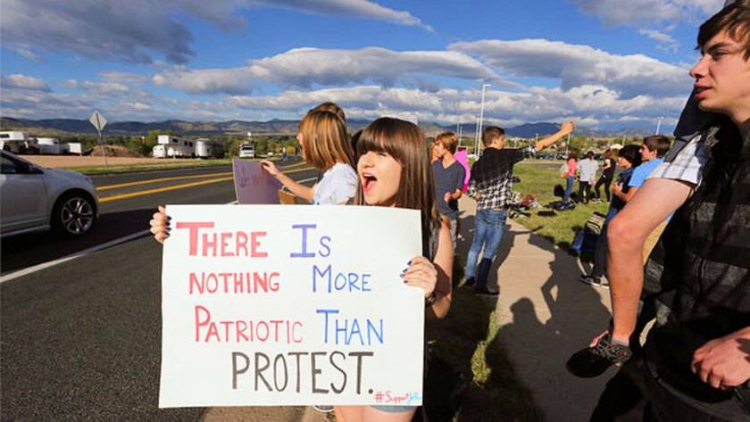 Students from schools in the Denver suburbs are protesting a proposal by the Jefferson County school board to emphasize patriotism and downplay civil unrest in the teaching of U.S. history.
