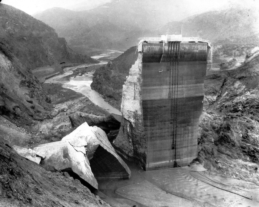 The remaining section of St. Francis Dam, with crumbled sections at base.