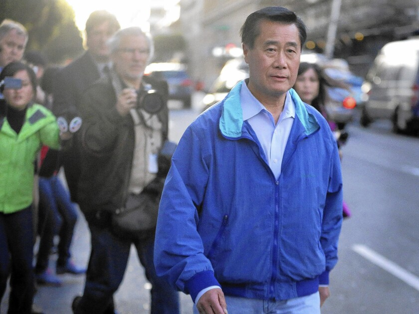 State Sen. Leland Yee leaves the federal building in San Francisco in March. He faces corruption and conspiracy charges. Lee was a candidate for secretary of state on Tuesday's ballot.