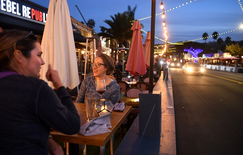 Friends dine in Redondo Beach. L.A. County has suspended outdoor dining at restaurants starting Wednesday.