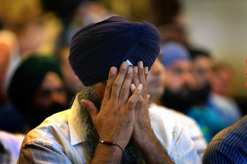 A member of the Milwaukee area Sikh community weeps as he listens to information about the Aug. 6 shooting spree in Oak Creek, Wisc.