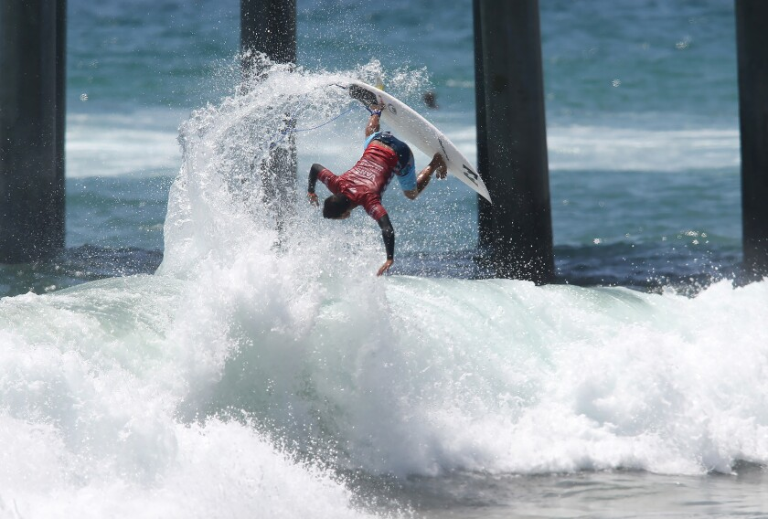 Seth Moniz completes an almost upside down backside air reverse in round 5 of the Men's US Open of Surfing on Saturday.