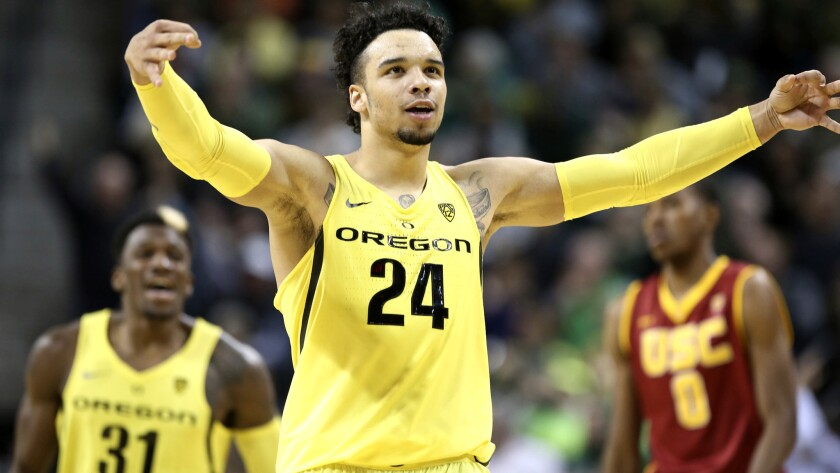 Oregon guard Dillon Brooks (24) celebrates after making one of his six three-point shots against USC on Friday night.