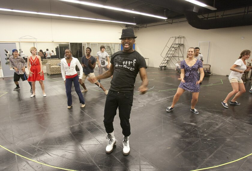 "B. Slade (center) rehearses a scene from ""The Who's Tommy"" with members of the San Diego Rep cast. Slade, a longtime gospel-music star formerly known as Ton3x, plays the title role in the rock musical."