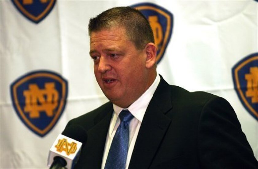 FILE -- In this Dec. 13, 2004 photo, new Notre Dame football coach Charlie Weis talks to the media during a news conference  in South Bend, Ind.  Notre Dame fired coach Charlie Weis on Monday, Nov. 30, 2009  after a string of disappointing seasons that was capped by an agonizing four-game losing st