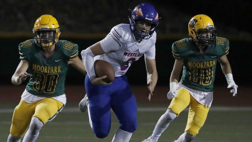Westlake quarterback Patrick Roberg scrambles for a long gain against Moorpark during the second half Friday night.