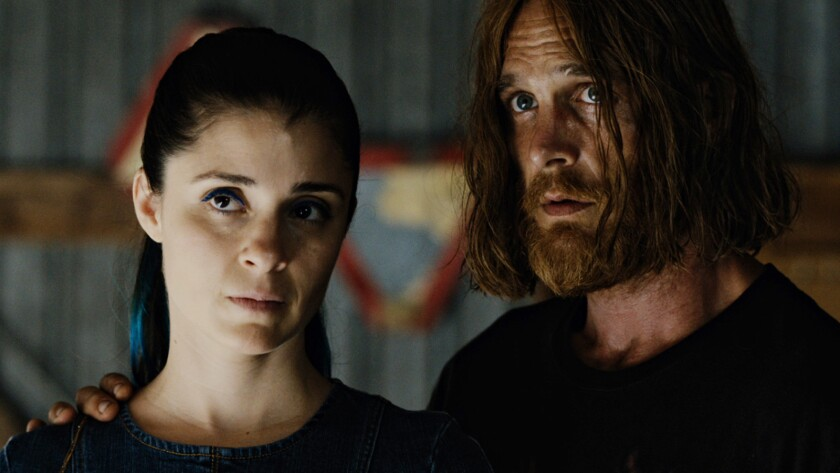 """Shiri Appleby and Ethan Embry in the film """"The Devil's Candy."""""""