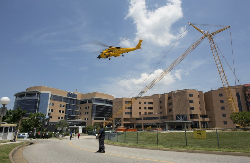 The first of two coast guard helicopters exits Sentara Norfolk General Hospital after bringing Navy aviators involved in a crash to the hospital, in Norfolk, Va., Thursday, May 26, 2016. Two Navy jet fighters collided off the coast of North Carolina during a routine training mission on Thursday, sending several people to the hospital, officials said. (L. Todd Spencer/The Virginian-Pilot via AP) MAGS OUT; MANDATORY CREDIT