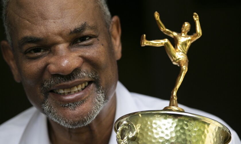 - Benn Fields holds a high jump trophy, Friday, July 31, 2020, in Salisbury Mills, N.Y. Fields will forever be known as a U.S. Olympian, he will also always wonder about what might have been had the U.S. government not spearheaded a boycott of the 1980 Olympic Games in Moscow. (AP Photo/Mark Lennihan)