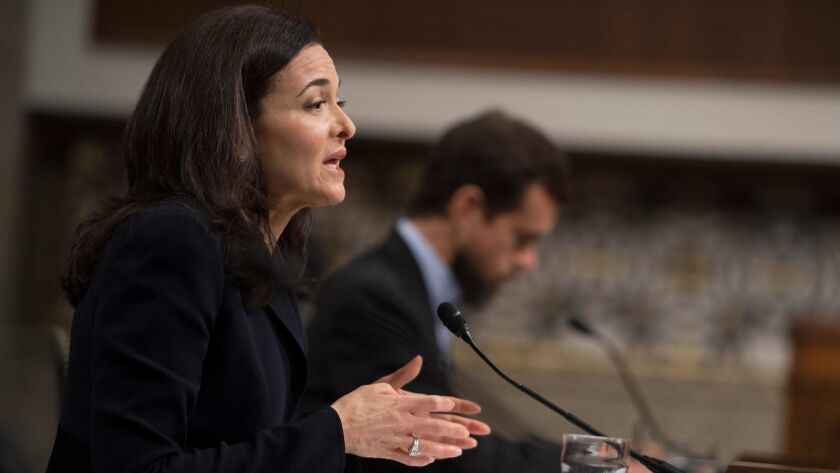 Facebook Chief Operating Officer Sheryl Sandberg and Twitter Chief Executive Jack Dorsey testify before the Senate Intelligence Committee on Capitol Hill on Wednesday.