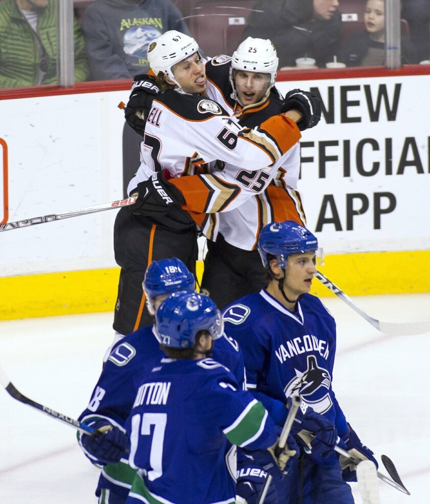 Anaheim Ducks' Rickard Rakell (67) celebrates his goal against the Vancouver Canucks with teammate Mike Santorelli (25) during the second period of an NHL hockey game Thursday, Feb. 18, 2016, in Vancouver, British Columbia. (Ben Nelms/The Canadian Press via AP)