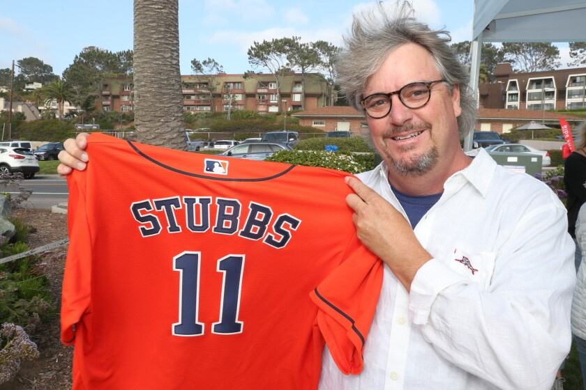 T. Pat Stubbs with his son's Houston Astros jersey