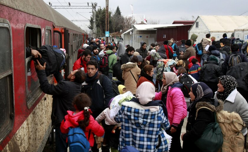 Refugees arrive by train at the transit center for refugees near northern Macedonian village of Tabanovce, before continuing their journey to Serbia, Wednesday, Feb. 10, 2016. Macedonian authorities are reinforcing a barrier at the country's border with Greece that is designed to limit the number o