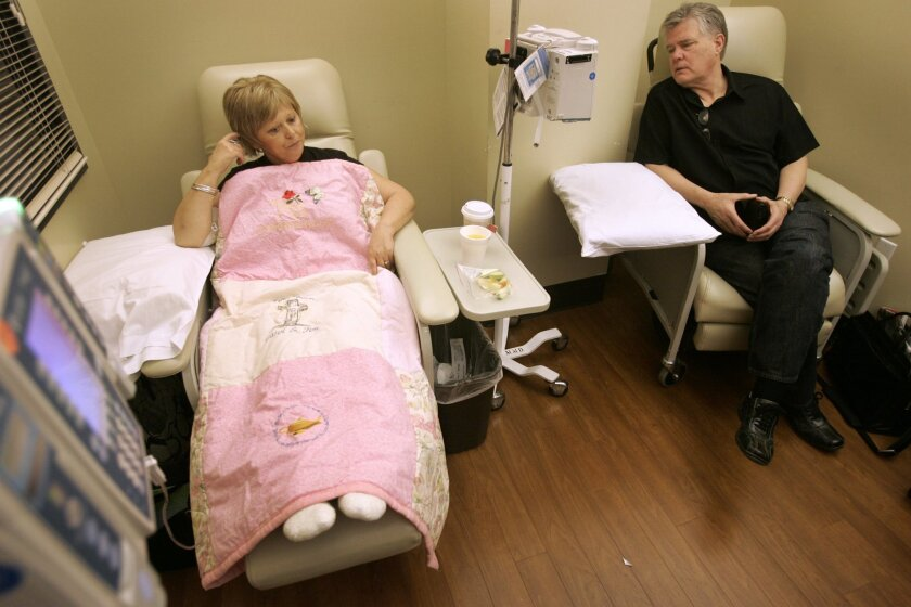 Carol Garlow, left, with her husband, Jim Garlow, right, during a recent chemotherapy treatment at Sharp Hospital.