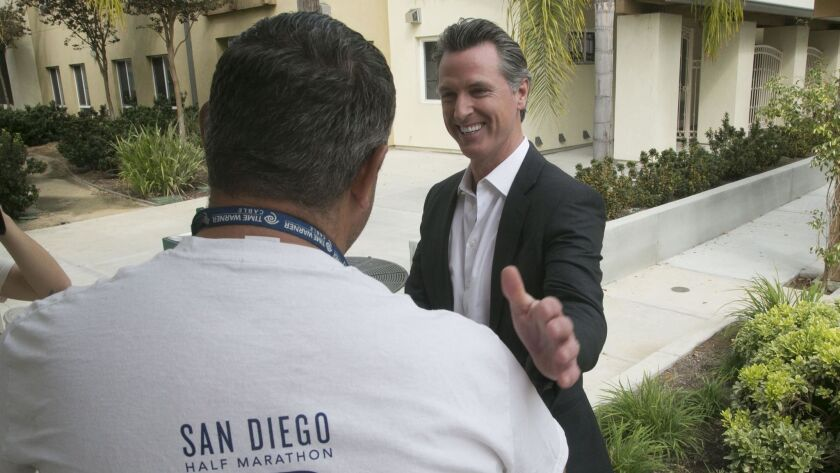 Gov. Gavin Newsom, shown here in a 2018 file photo, signed a bill this week that critics say could make it harder for policyholders to collect benefits from pet insurance policies.