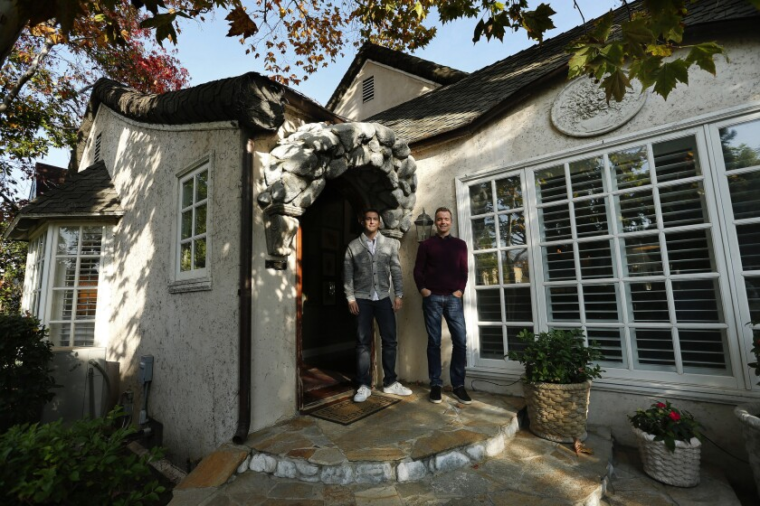 Tom Balamaci, left and Patrick Wildnauer balanced quality with savvy spending as they re-envisioned their 1927 cottage in Wilshire Vista. They worked with interior designer Amalia Gal. The results combine traditional elegance and personal style.