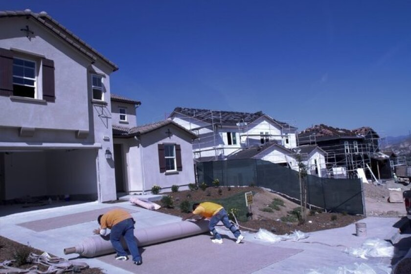Construction spending rises, fueled by gains in home building