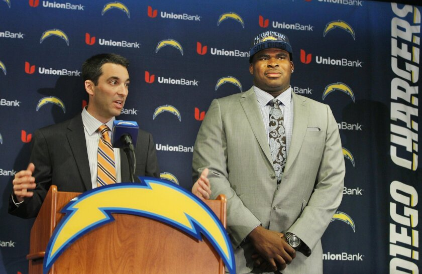 Tom Telesco, left, did a fine job drafting D.J. Fluker and others last year. The Chargers GM is focused on a repeat performance this year.