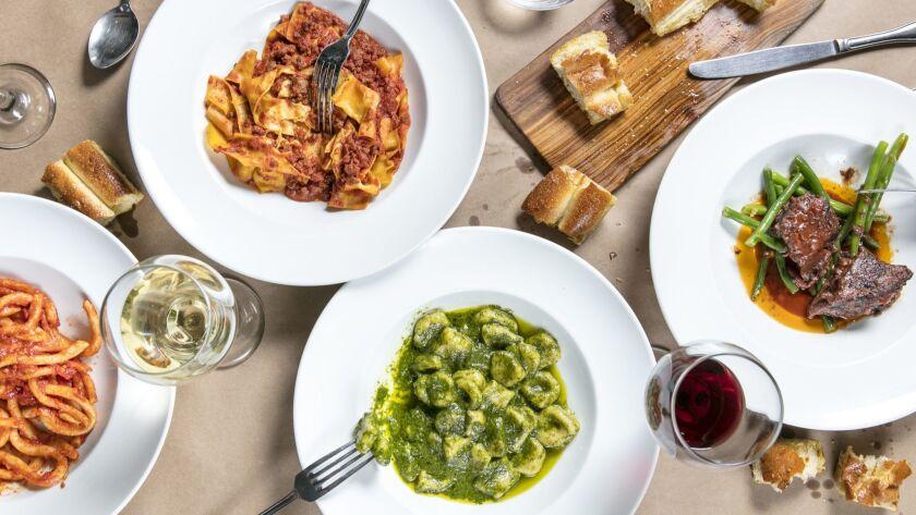 (Left to right) Pici all'aglione (a hand-rolled pasta with a garlic tomato sauce); tagliatelle con sugo di carne (hand-cut egg pasta with a meat tomato sauce); gnocchi with pesto; Il brasato el gronchi (short rib); and focaccia bread at Bulgarini, a restaurant in Altadena.