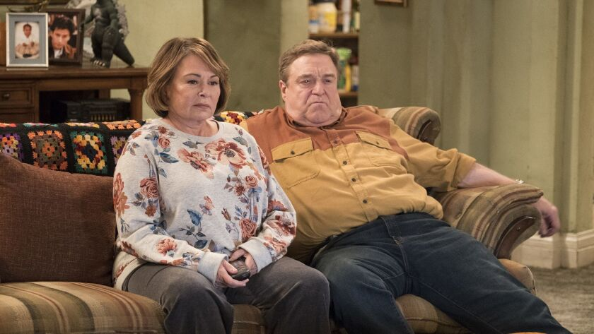 FILE - In this image released by ABC, Roseanne Barr, left, and John Goodman appear in a scene from t