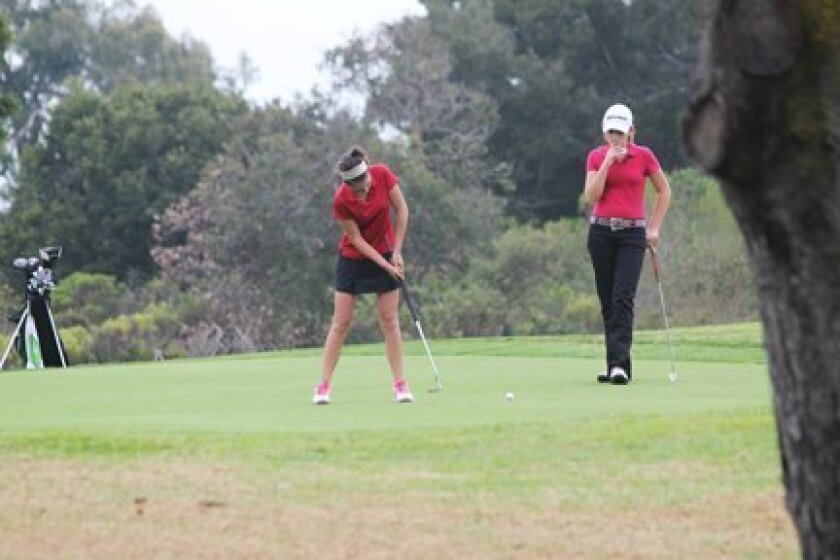 La Jolla senior Juliette Garay putts while freshman Daniella Anastasi looks on last week at Torrey Pines. Phil Dailey Photo
