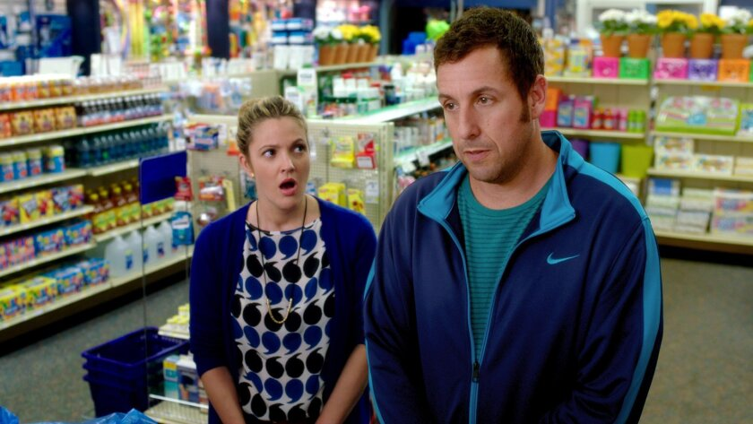 """This image released by Warner Bros. Pictures shows Drew Barrymore, left, and Adam Sandler in a scene from """"Blended."""" (AP Photo/Warner Bros. Pictures)"""