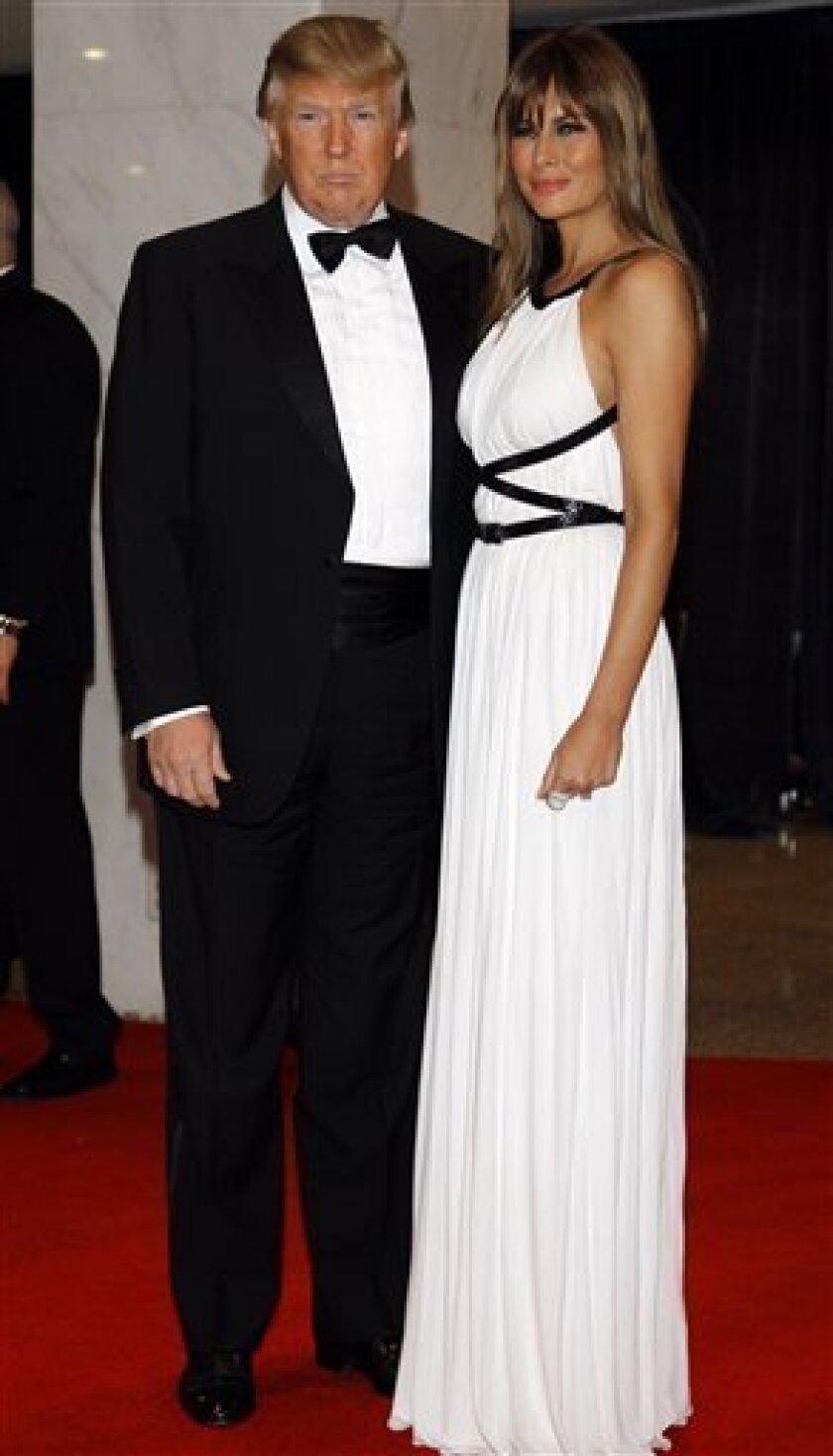 Donald Trump and his wife Melania Trump arrive for the White House Correspondents Dinner Saturday, April 30, 2011 in Washington.(AP Photo/Alex Brandon)