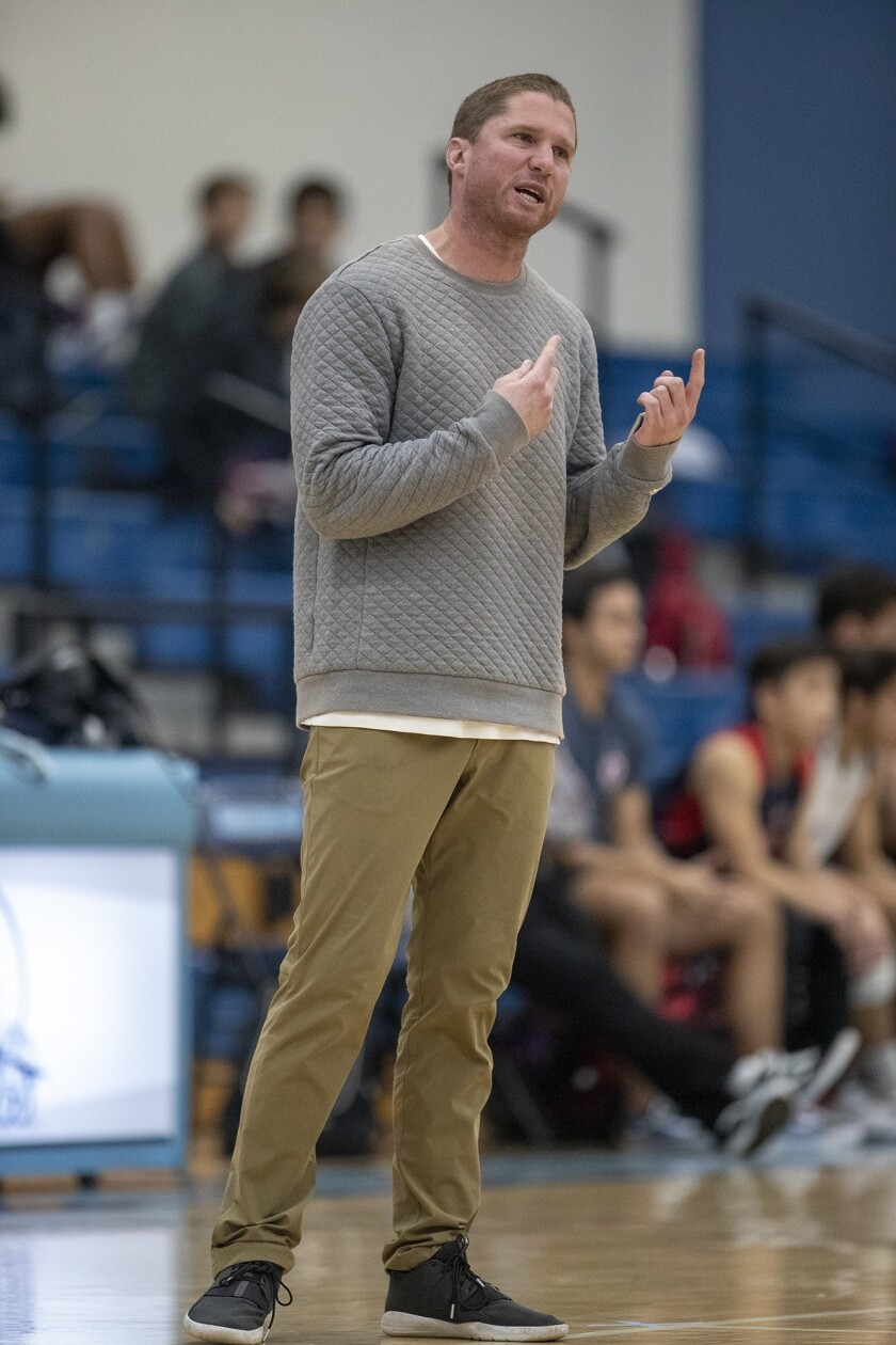 Corona del Mar's coach Sam Stafford gives directions to his team during a nonleague match against Be