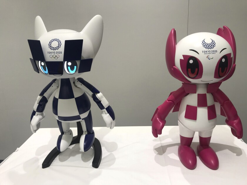 Robots of Tokyo 2020 Olympics mascots Miraitowa, left, and Someity are shown to the media Thursday at Toyota Motor Corp. headquarters in Tokyo.