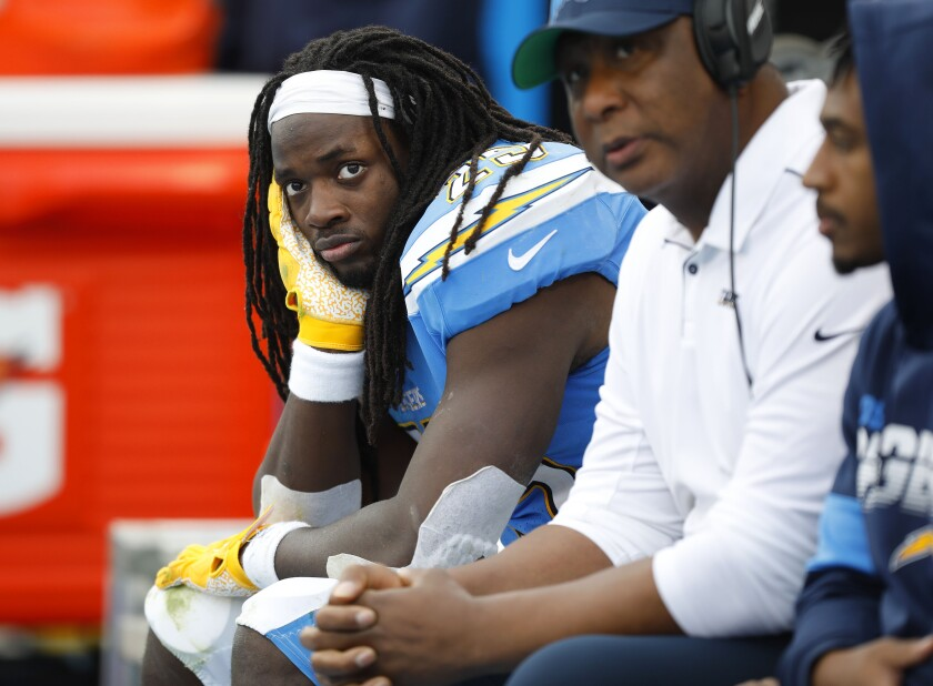 hargers running back Melvin Gordon sits on the bench.
