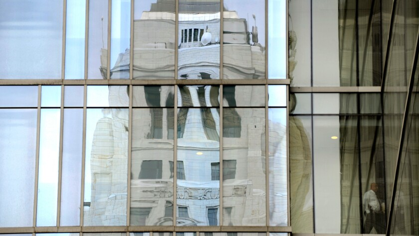City Hall is reflected in the windows of LAPD headquarters in downtown Los Angeles.