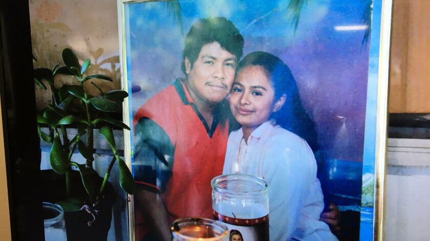 This photo of Ismael Lopez, left, and his wife Claudia, was shown to reporters during a news confere