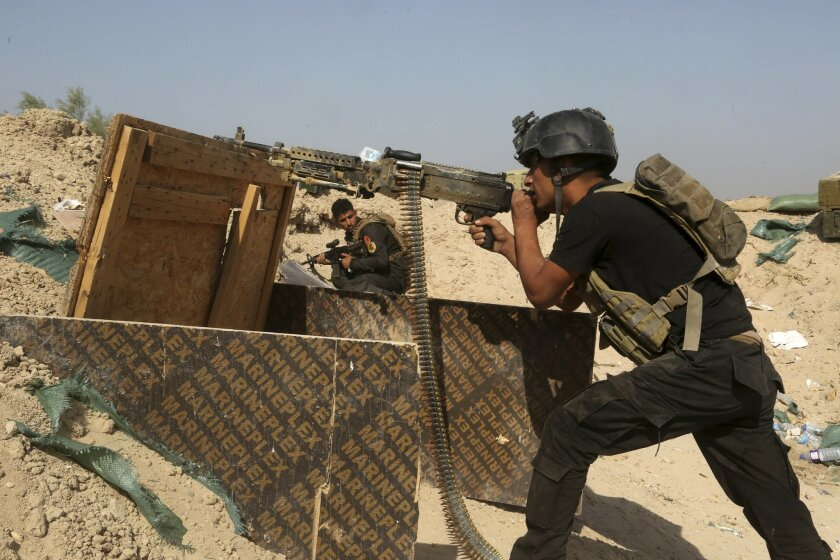 FILE - In this Wednesday, June 1, 2016 file photo, Iraqi counterterrorism forces face off with Islamic State militants in the Nuaimiya neighborhood of Fallujah, Iraq. Iraq's government is setting its sight on Mosul, Iraq's second largest city that has been under IS control since June 2014, as its n