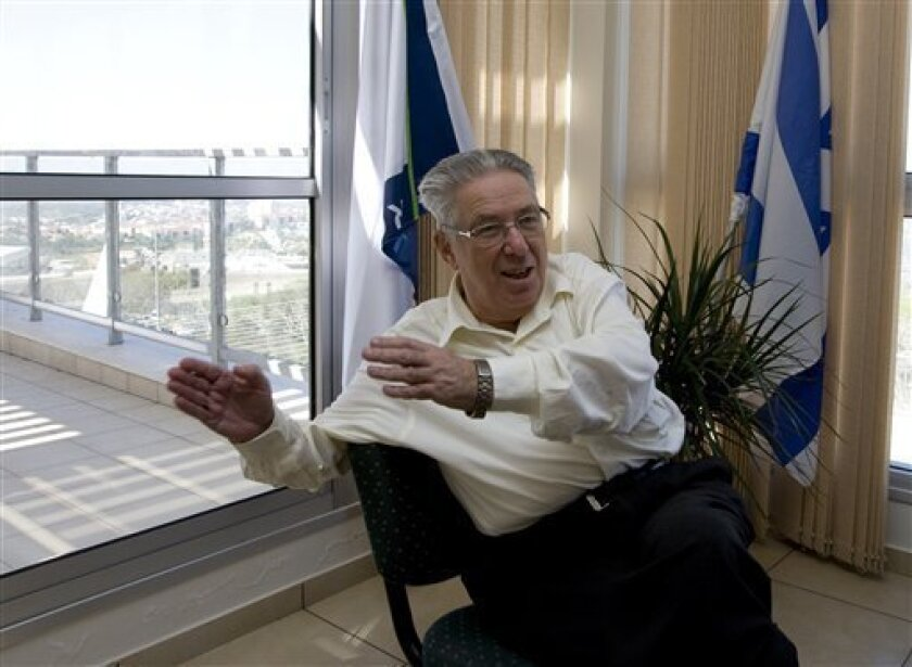 In this photo taken Tuesday, Feb. 2, 2010, Ariel college president Dan Meyerstein speaks during an interview with The Associated Press in his office in the West Bank Jewish settlement of Ariel. The planned upgrade of the college with 8,700 full-time and 2,500 part-time students is perhaps the most