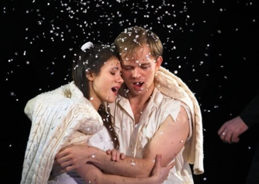 "This publicity image released by DDPR - Public Relations shows Evy Ortiz, left, and Jim Schubin in ""The Fantasticks."" This Sunday, that little show _ with a cast of eight, two musicians, a cardboard moon and guy who sprinkles confetti and makes us believe its snow _ will celebrate a staggering milestone: 20,000 performances. (AP Photo/DDPR - Public Relations, Graham Dougherty)"