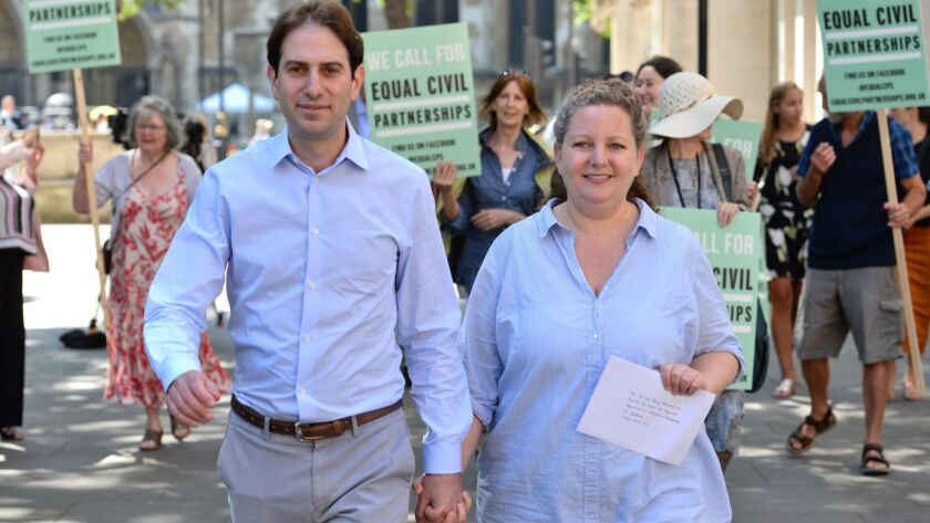 Rebecca Steinfeld and Charles Keidan outside the Supreme Court in London, where they have won their