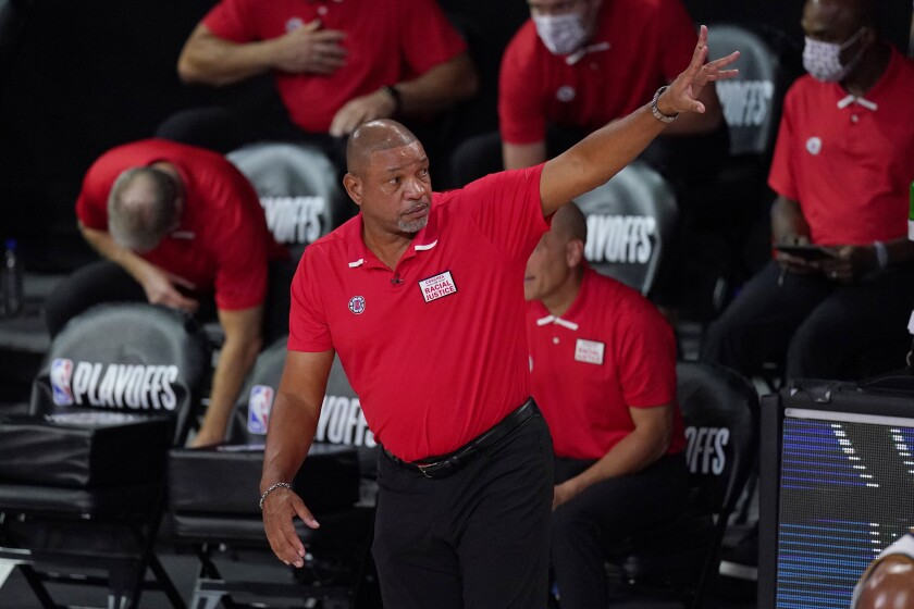Former Clippers coach Doc Rivers gestures during a game.