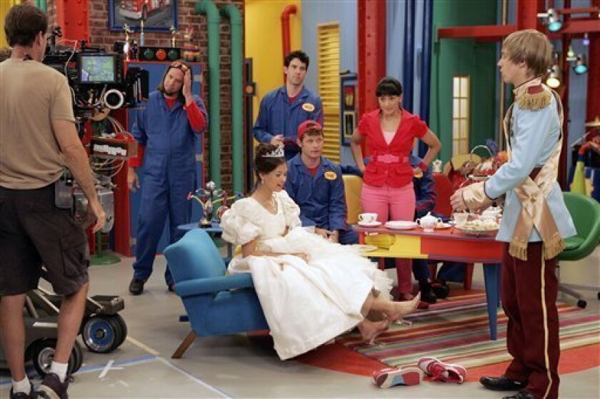 Cinderella, played by Nicole Anderson, and Prince Charming, played by Jason Dolley, rehearse a scene with the Imagination Movers in Harahan, La., Tuesday, June 16, 2009. Looking on are, standing, back, from the left; Scott Durbin, Rich Collins and Wendy Calio, and sitting is Dave Poche. The group was preparing to film an esposide of the Imagination Movers TV show, which airs on the Disney Channel.(AP Photo/Bill Haber)