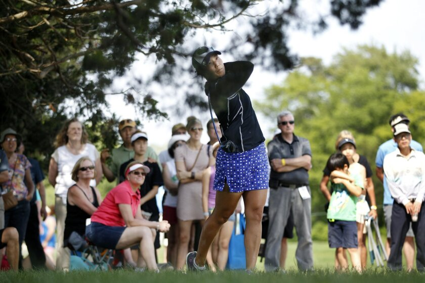 Tiffany Joh hits from the trees on the ninth hole of the second round of the ShopRite LPGA Classic golf tournament, Saturday, June 4, 2016, in Galloway Township, N.J. (AP Photo/Mel Evans)