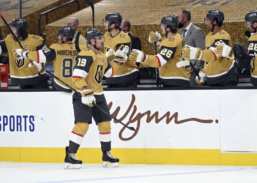 Vegas Golden Knights right wing Reilly Smith (19) celebrates with teammates after a goal against the St. Louis Blues during the third period of an NHL hockey game Saturday, May 8, 2021, in Las Vegas. (AP Photo/David Becker)