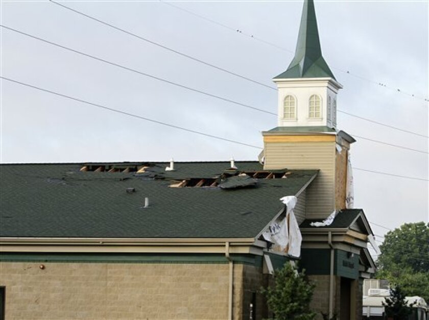 The chapel in the stable area at Churchill Downs in Louisville, Ky., shows roof damage Thursday, June 23, 2011, following a possible tornado that damaged at least nine barns Wednesday night. The National Weather Service sent teams out Thursday to determine whether the funnel cloud reported in the area was the cause of the damage. (AP Photo/Garry Jones)