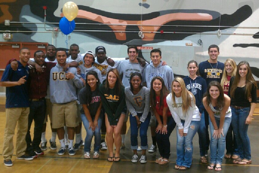 El Camino High athletes who will be competing in college gather for a photo to celebrate moving on to the next level.