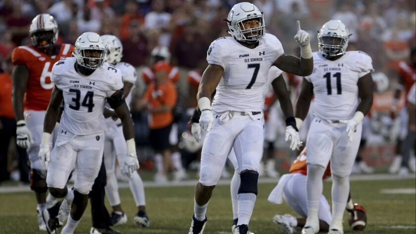 Old Dominion's Oshane Ximines reacts after a first down during the second half of an NCAA college fo