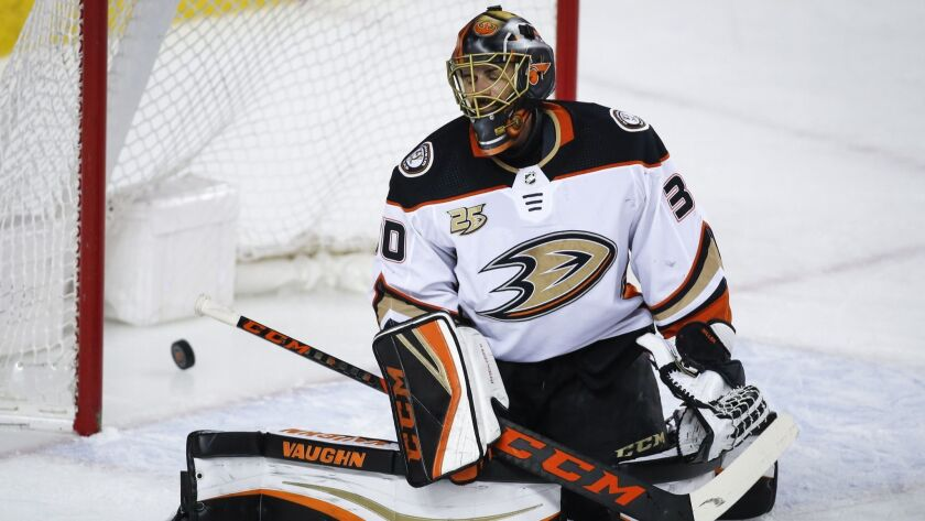 Anaheim Ducks goalie Ryan Miller reacts after letting in a goal to the Calgary Flames during the fir