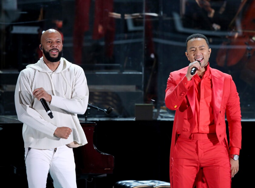 Rapper Common, left, onstage with John Legend.
