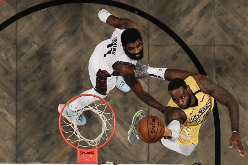 A view from above as Lakers' LeBron James drives to the rim past Brooklyn Nets' Kyrie Irving