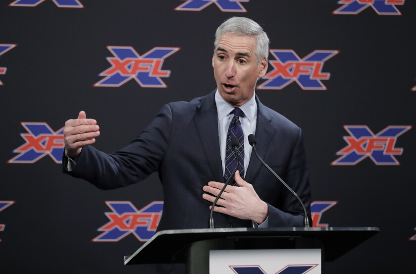 XFL Commissioner Oliver Luck talks to reporters in February in Seattle.