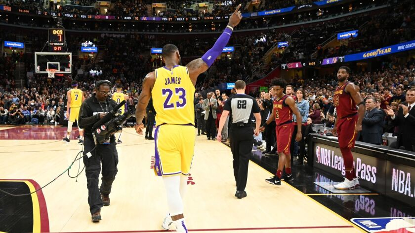 LeBron James recognizes the fans after the Cleveland Cavaliers honored James during a timeout at Quicken Loans Arena.